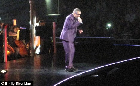 Dapper: The singer performed in a smart purple suit for the second half of the two 'act' concert