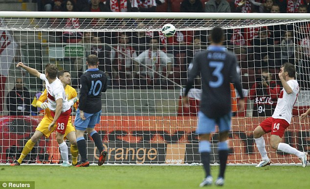 Opening salvo: Wayne Rooney got his shoulder to the ball to put England in front in Warsaw