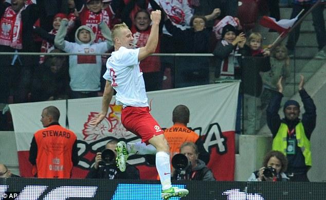 Main man: Glik celebrates after heading home the equaliser for Poland against England