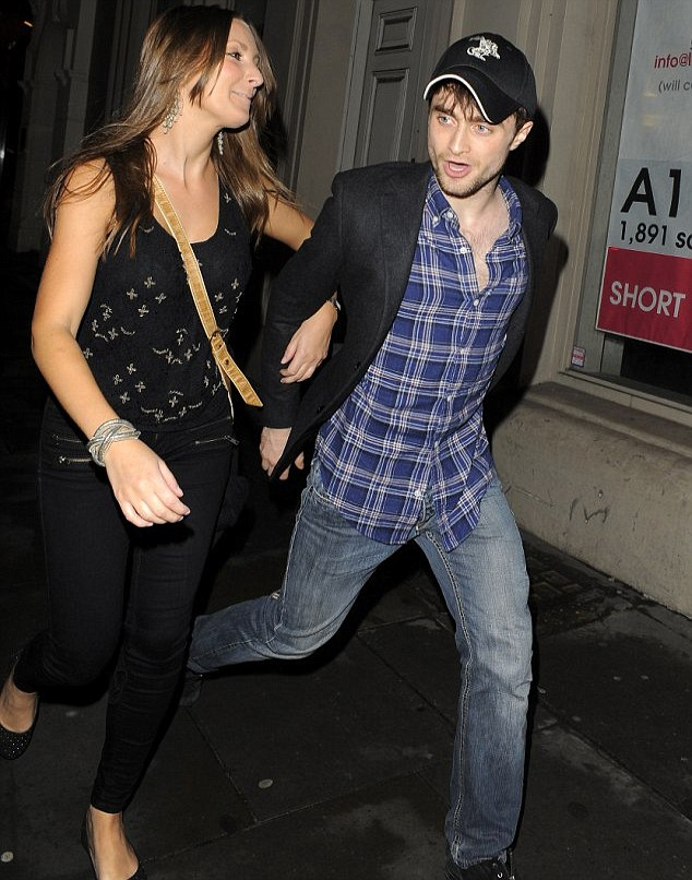 Mystery woman: Daniel Radcliffe enjoyed a night out in London with a brunette in August