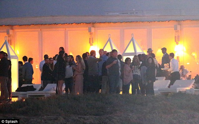 The night of a thousand stars: The guests drank and chatted as the night went on, standing next to giant lanterns