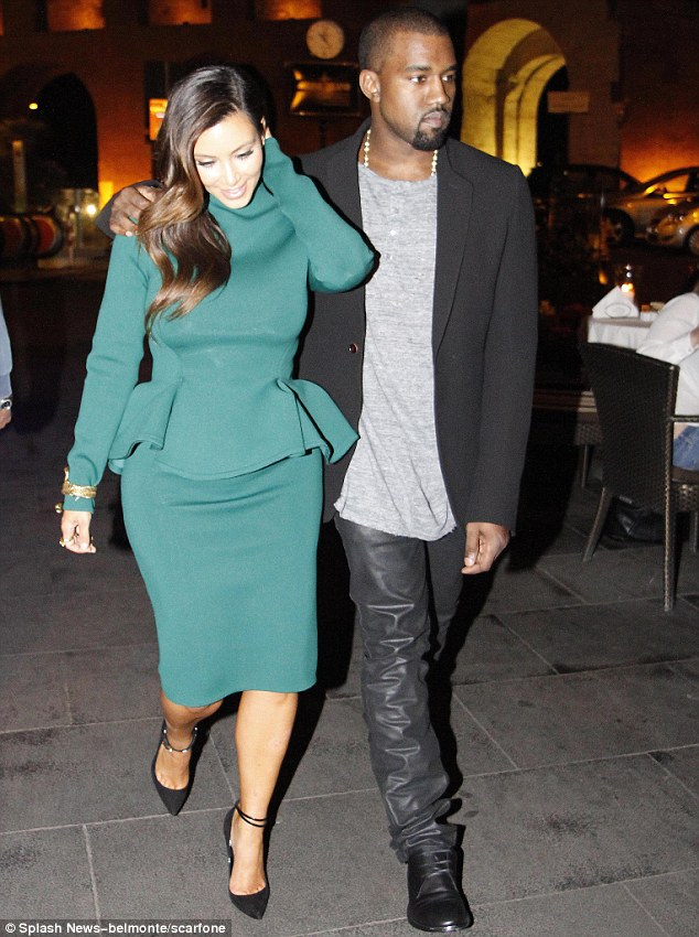 Shiny happy people: It was Kanye West's turn to wear leather trousers as he stepped out for a romantic meal in Rome on Thursday night with his girlfriend, Kim Kardashian