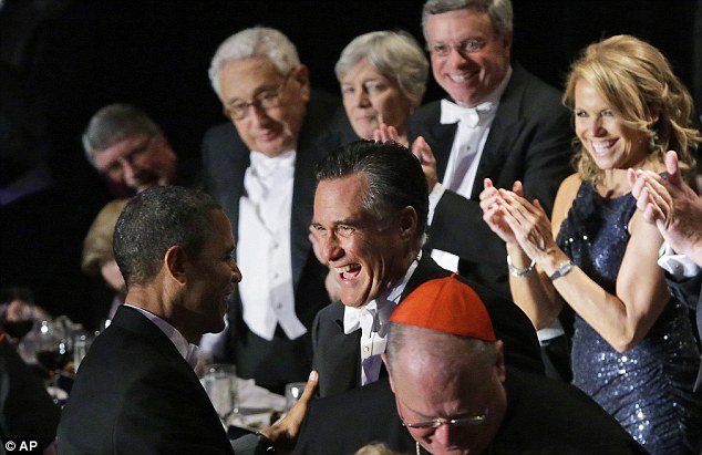 Better spirits: Romney and Obama grin at each other, (as Katie Couric and Henry Kissinger look on) after their  joke-filled addresses at the Al Smith dinner in New York