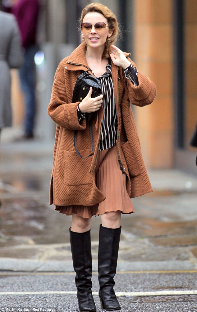 Autumnal chic: Kylie Minogue stepped out in a colour coordinated brown ensemble as she ran errands in London on Friday