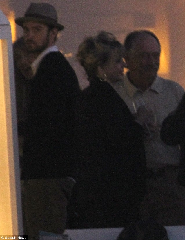 Preparations: Justin was spotted enjoying pre-wedding drinks with a group of guests on Wednesday night in Brindisi, Italy