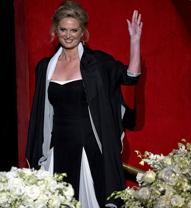 Glamour: Ann Romney waves to the crowd as she attends the annual dinner in New York dressed in a sweeping black and white gown