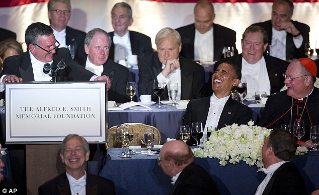 Hilarity: The President bursts out laughing as Al Smith addresses him at the 67th Annual Alfred. E. Smith Memorial Foundation Dinner at the Waldorf Astoria