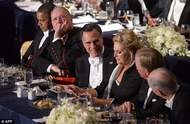 Dinner party: Obama looks over his notes, Cardinal Dolan appears contemplative while Mitt Romney laughs with fellow guests and Ann focuses on her dessert