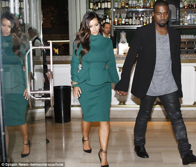 Double trouble: Kanye doesn't have to deal with two Kims, the other one is just a reflection
