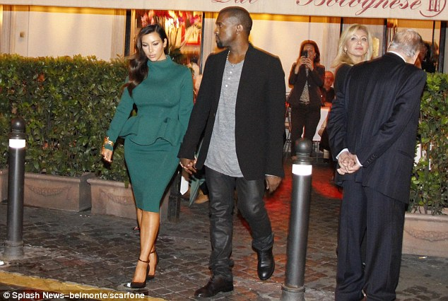 Spaghetti stop: Kim and Kanye leave the restaurant after their romantic meal