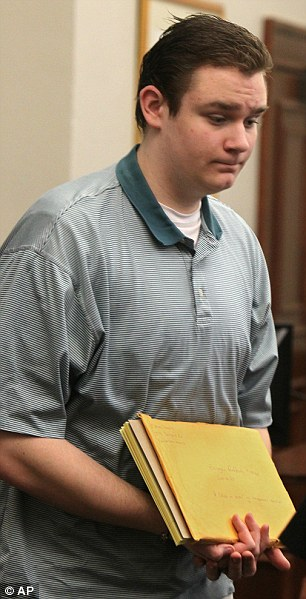 Confession: Brogan Rafferty leaves the courtroom of Summit County Common Pleas Court during his trial on Tuesday for the murder of three men and attempted murder of one in Noble County, Ohio