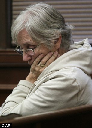 Ellen Kern, mother of Timothy Kern, 47, the last victim, listens to the playing of the confession statement
