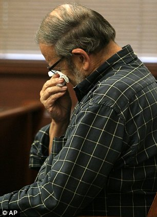 Jack Kern, father of Timothy Kern, 47, the last victim, wipes his eyes after hearing how his son was killed