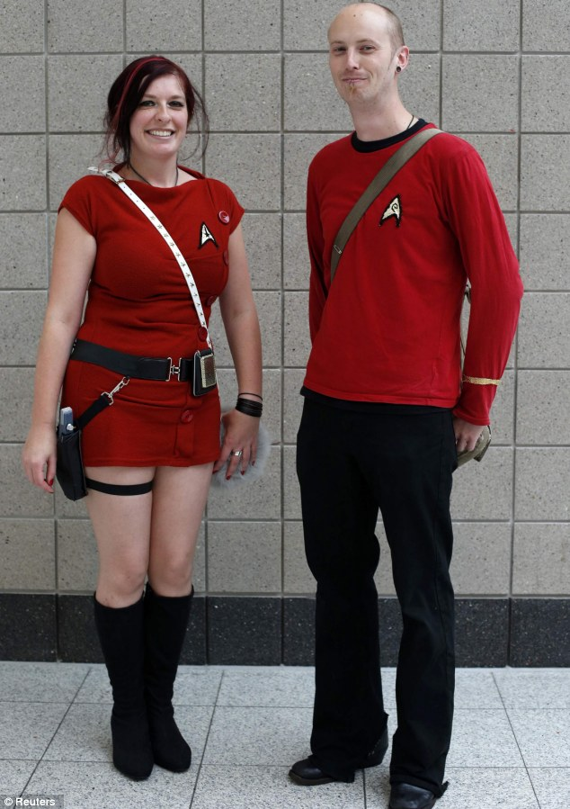 "Sci-fi fans: Scarlet Frost and Luke Earl of Farnborough, England pose for a photograph as they arrive at the ""Destination Star Trek London"" convention in London"