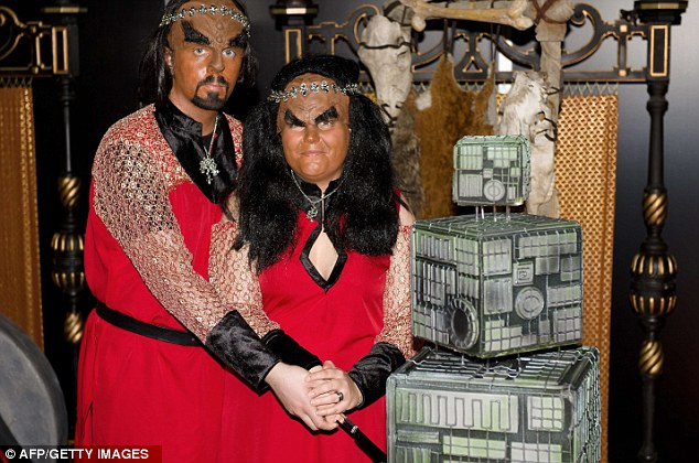 Clinging-on to one another: Sonnie Gustavsson (left) and Jossie Sockertopp of Sweden wear full Klingon costumes during their marriage ceremony