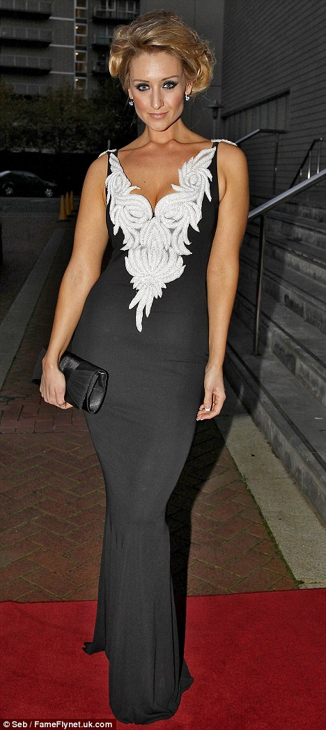 Sizzling: Catherine Tyldesley knows how to make a red carpet entrance as she attends charity gala in Manchester