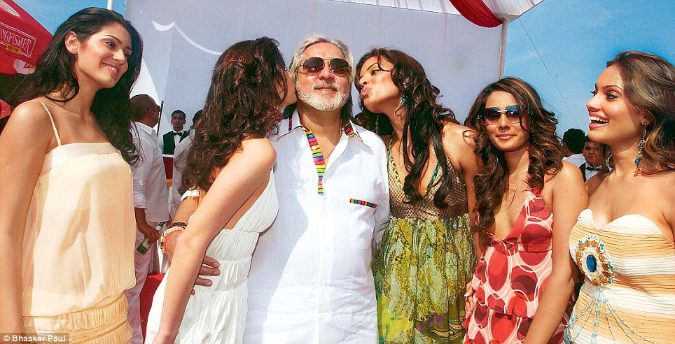 When times were good:  Vijay Mallya exulting in the company of Kingfisher calendar models