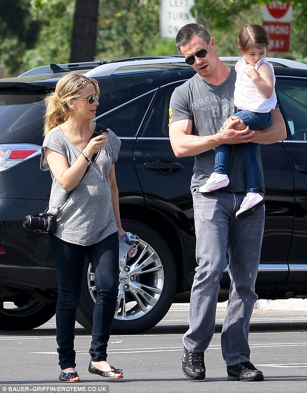 Family day: Sarah and her husband Freddie Prinze Jr. have been married 10 years. Here they're pictured taking their daughter Charlotte to the Los Angeles Zoo last May when Sarah was still pregnant with their second child