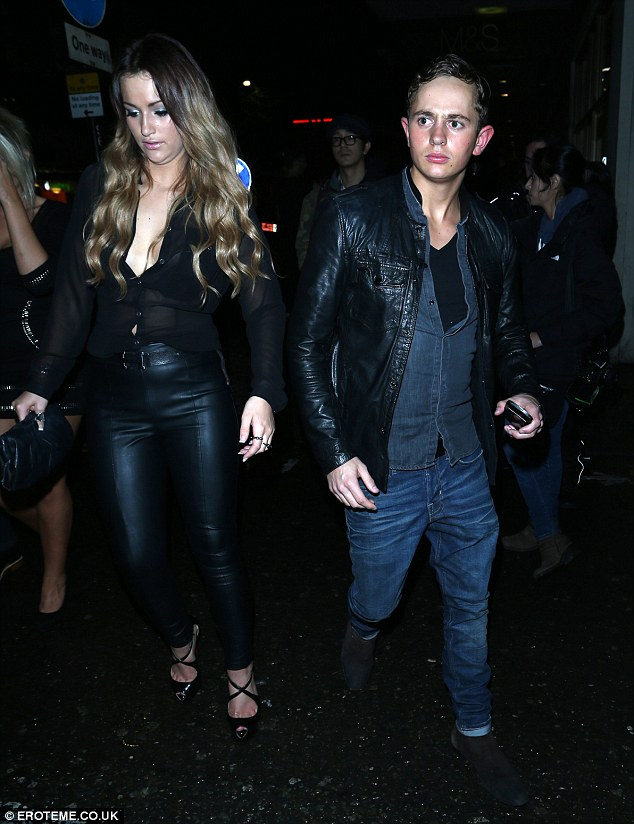 Ladies' man: George Lineker continues his Lothario image as he heads out of a club with four women in tow