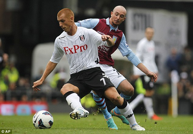 Holding off his man: Steve Sidwell keeps the ball from Stephen Ireland