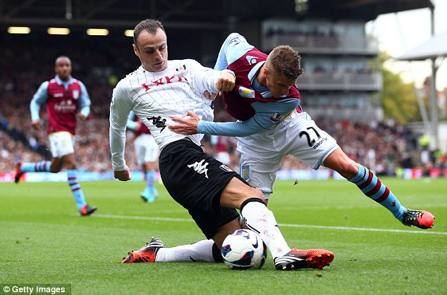 Fight for the ball: Dimitar Berbatov wins the ball for Fulham