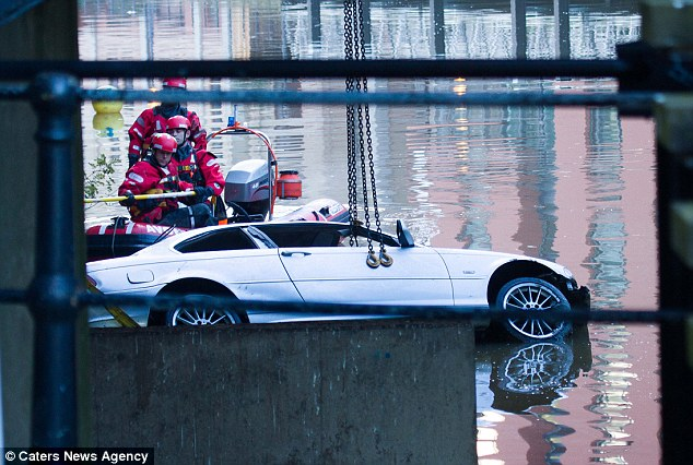 Salvage operation: Investigators believe Ms Whisker was the front-seat passenger of the car when it went into the river