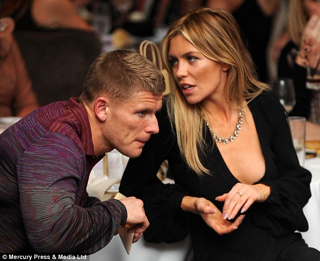 Oops! Abbey could barely contain her cleavage as she talked to a pal at the fashion show