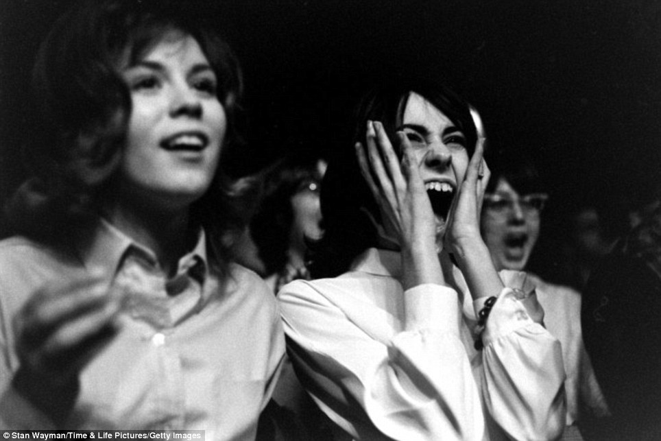 Overwhelming affection: A young woman slaps her hands to her face while screaming making up a room full of cries that prevented the band from hearing themselves play