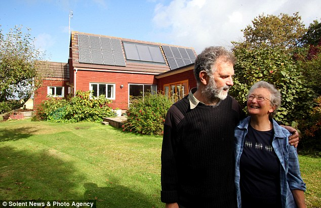 The cosy home is almost completely powered by solar and green energy, including solar panels (pictured)