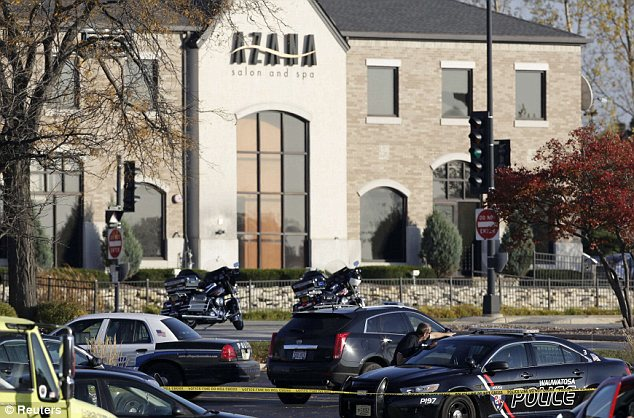 Police tape surrounds the the Azana Salon and Spa in Brookfield, where Haughton shot seven people - killing three of them