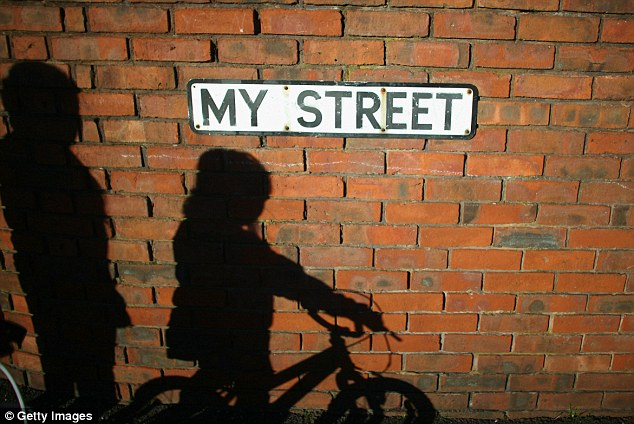 The shadows of children playing are cast on the wall of My Street in Salford. More families are claiming housing benefit as private rents have risen by 37 per cent in six years