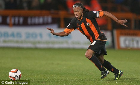 Suit you, sir: Davids has made a big impact following his arrival at Barnet