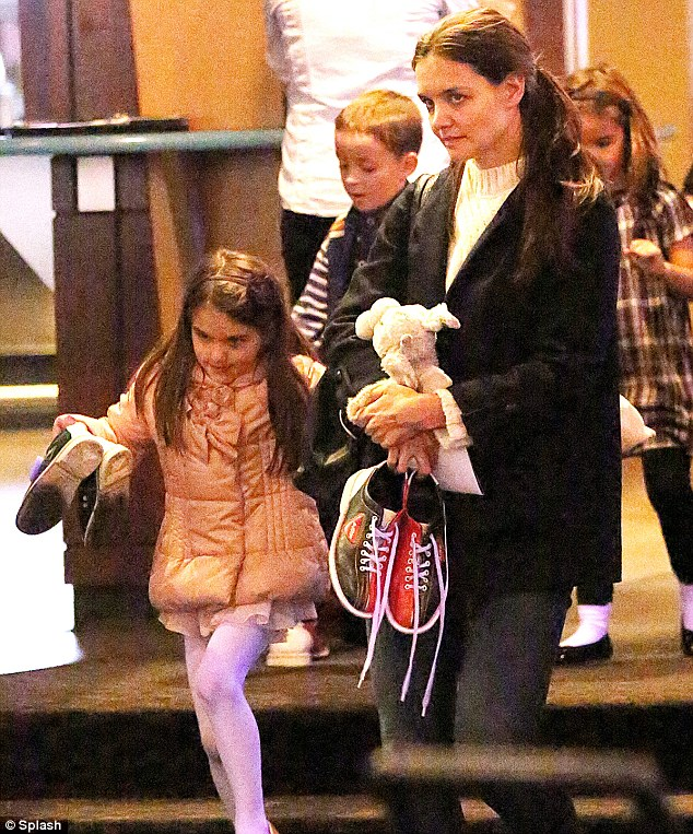 Busy day: Katie and Suri enjoyed a spot of bowling at 300 Lanes at Chelsea Piers in New York on Sunday afternoon
