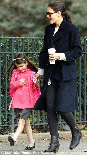Spring in her step: Katie appeared to be in need of caffeine fix and opted for a large coffee