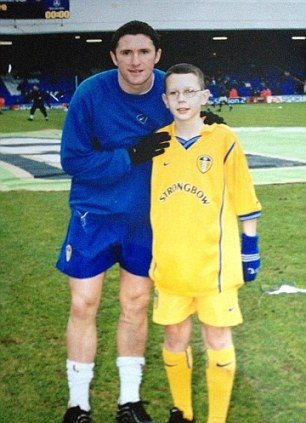 Early years: Cawley - once a Leeds mascot - poses with Robbie Keane