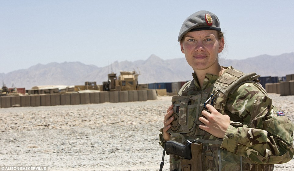 Ready for action: Captain Crossley, a nurse at UCL hospital on a six-month tour in Afghanistan, stands in full military gear against a backdrop of mountains