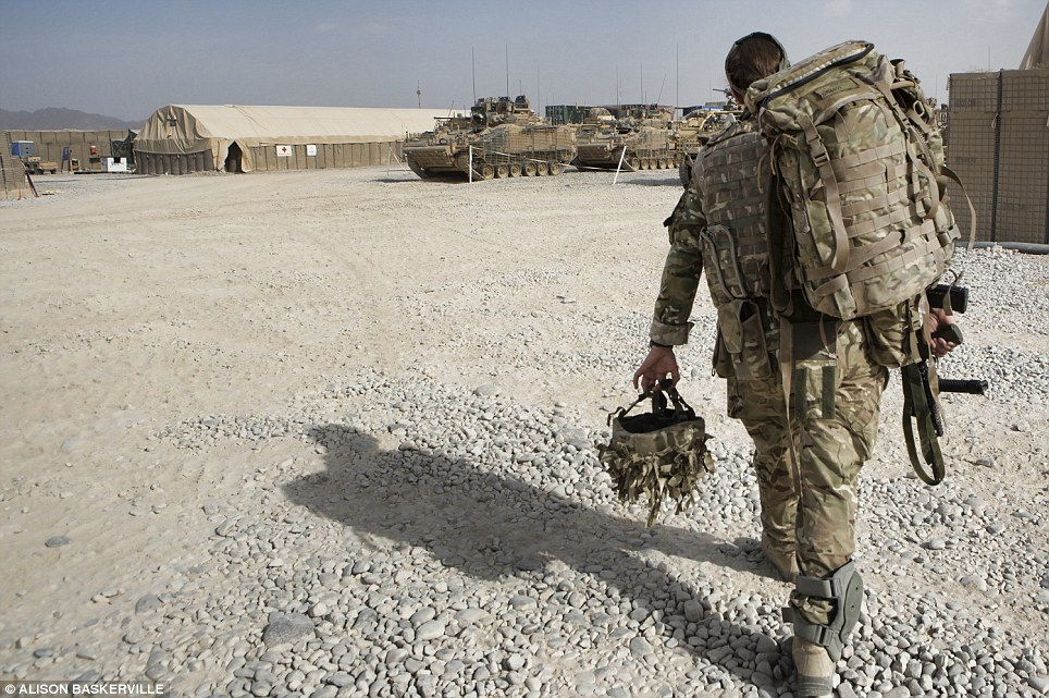Captain Crossley heads out to join soldiers from 3 Rifles as they prepare for a patrol to help her gain entry into a local compound