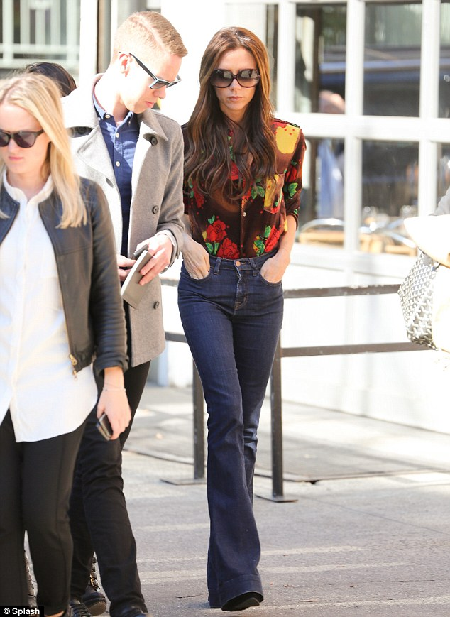 Not her usual look: Victoria teamed the wide-legged jeans, which made her legs look tiny, with a patterned shirt