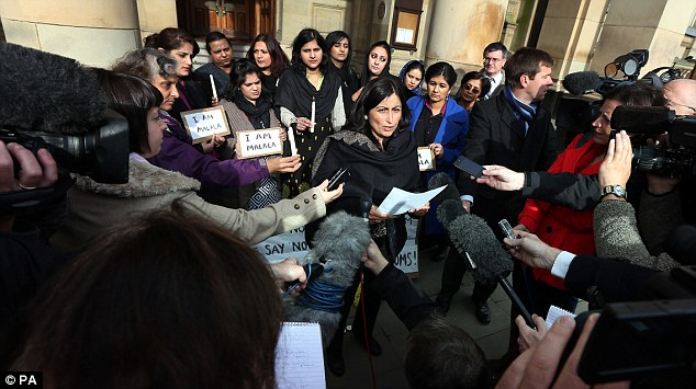 Support: Campaigners gather for a vigil for Malala Yousafzai in Birmingham's Victoria Square last week