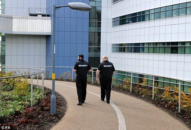 On guard: Security patrol the Queen Elizabeth Hospital, Birmingham, where Malala Yousafzai is being treated