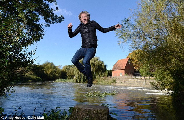 Water performance: Jimmy Bullard in a shoot with Sportsmail snapper Andy Hooper