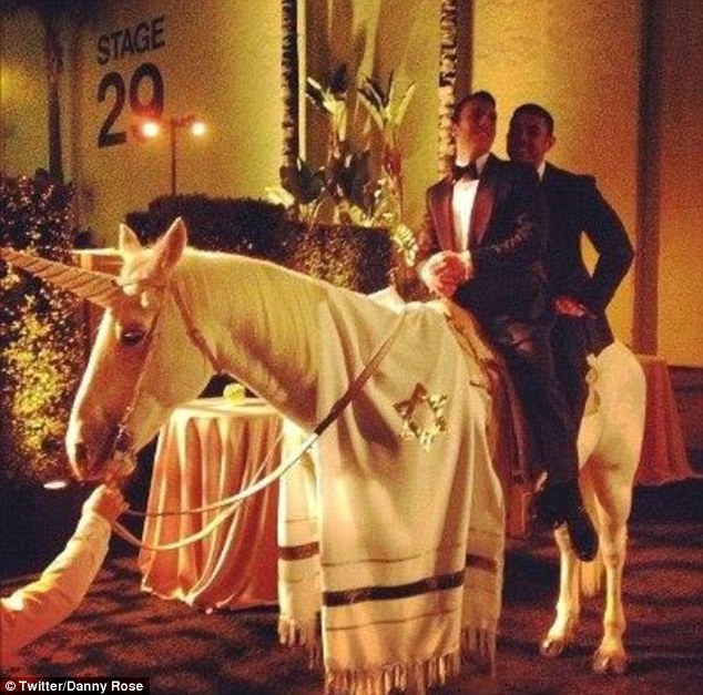 Pulling out all the stops: Cougar Town producer Danny Rose and husband Aaron Rosenberg ride the 'Jew-nicorn' on their amazing wedding day in Los Angeles