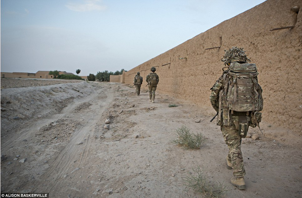 All equal: The soldiers look exactly the same as one another as they go on patrol