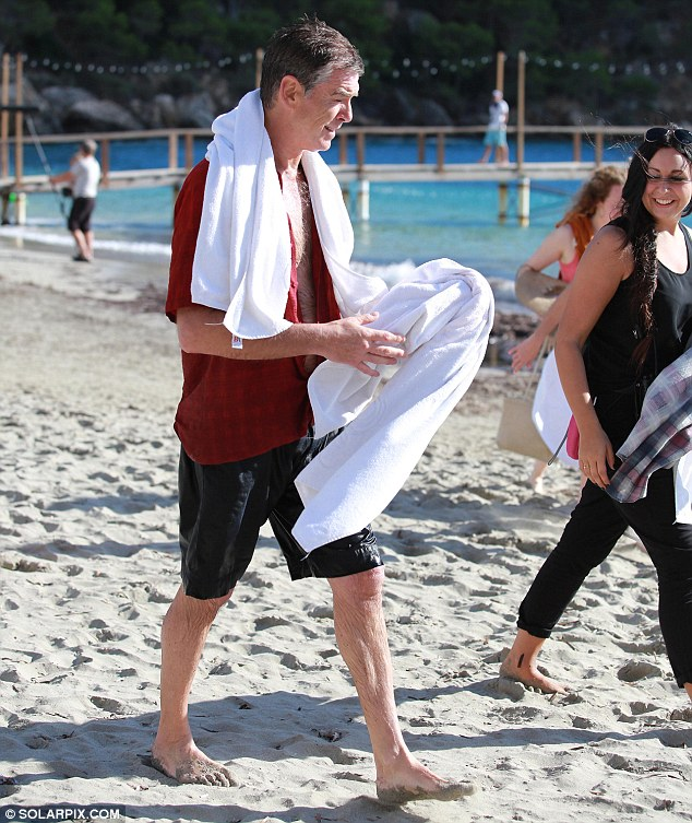 Hard day at work: The actor spent Monday afternoon on the beach and in the sea as part of the movie schedule