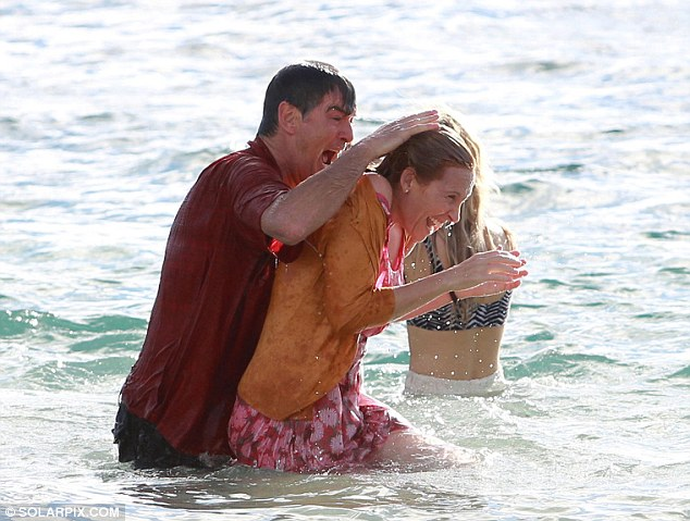 Take that! He threw himself into character as he dunked co-star Toni Collette in the sea while they were both fully clothed