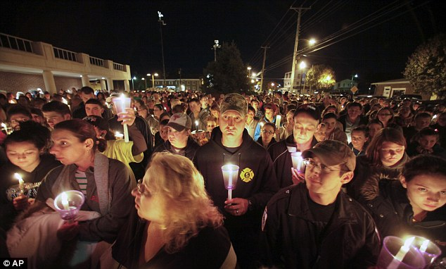 Coming together: Residents of Clayton take part in a candlelight vigil for Autumn last night, shortly before it was announced that her body had been found