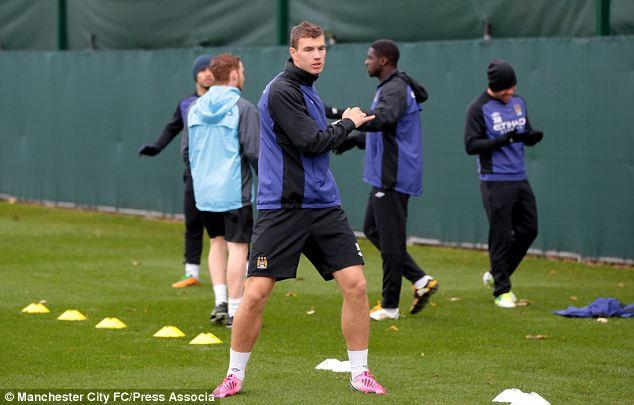 Raring to go: Manchester City's Edin Dzeko