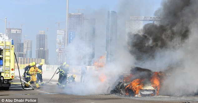 Horrific: Pictures from the scene of the crash show the Lamborghini going up in flames after it crashed on Saturday