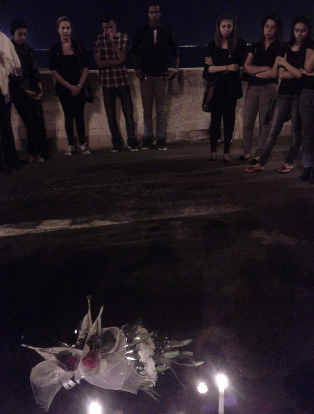 In memory: Devastated friends gather at the crash site where Mrs Ghais lost her life