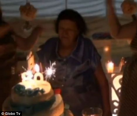 Tragedy: A blurry home video shows the victim celebrating her 80th birthday with her family